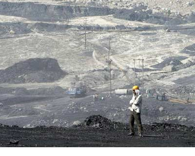 <p><b>A miner stands at a coalmine in Chhattisgarh</b>