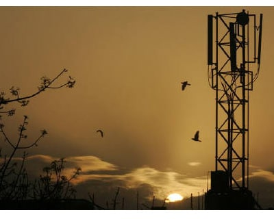 <p><b>The sun rises behind a communications tower in New Delhi</b> </p><p> The Supreme Court said on Thursday it will oversee a widening investigation into allegations of corruption in the sale of telecoms licences worth billions of dollars, a scandal touching the heart of government. </p><p> The government has struggled to contain the fallout from the sale of lucrative mobile phone licences at below-market prices in 2007-08. The scandal, potentially costing the state $39 billion in lost revenues, has already brought down telecoms minister A. Raja and kept parliament deadlocked for weeks. </p><p> Opposition parties have demanded a full parliamentary inquiry into what could be the country&#39;s biggest graft case. The government has refused, fearful it might force the prime minister to testify. </p><p> The case has shaken the credibility of the government of Prime Minister Manmohan Singh, who has also been forced to defend himself at the Supreme Court over his handling of the al
