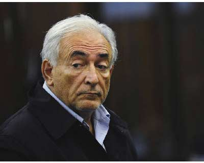IMF chief Dominique Strauss-Kahn listens as he stands before judge Melissa Jackson during his arraignment in Manhattan Criminal Court in New York</p><p><b>IMF chief Dominique Strauss-Kahn bedded down at New York&#39;s notorious Rikers Island jail on Monday night in a rapid and dramatic fall from grace after he was charged with trying to rape a hotel maid.</b></p><p>Separated from other inmates for his own safety, Strauss-Kahn was put in a bare 11-by-13-foot (3.5-by-4-meter) cell and given basic bedding, a drinking cup, soap, shampoo and toothpaste.</p><p>Just three nights earlier, Strauss-Kahn had slept in a luxurious $3,000-a-day hotel suite complete with conference room, living room, marble bathroom and a bedroom with a king-sized bed and feather and down duvet.</p>