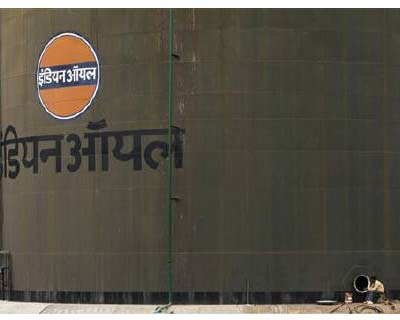 """A worker sits beside an oil tank at a storage facility of an oil company on the outskirts of New Delhi</p><p><b>India's biggest oil refiner and fuel retailer IOC could slow some domestic expansion projects as the company incurs heavy losses on the sale of subsidised fuel, its head of finance said on Tuesday.</b></p><p>""""We are ready with detailed feasibility reports and all. We will see what is the best time to launch them, may be once the situation on subsidised fuel becomes clear,"""" PK Goyal said in his first interview after assuming the post on May 2.</p><p>India's government currently caps prices of diesel and kitchen fuels and the shortfall is covered by state spending, upstream companies and the refiners.</p>"""