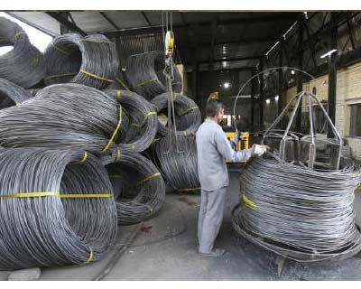 """A labourer works inside an electrode factory on the outskirts of Jammu</p><p><b>State-run SAIL will likely launch its share sale by June 14, after the board of directors of the steelmaker finalise the draft prospectus early next week, its chairman said.</b></p><p>""""We have tentatively scheduled it from June 14 to June 17. The prospectus is yet to be filed, but the board will meet on May 23 to finalise this,"""" SAIL Chairman CS Verma told Reuters over the telephone from New Delhi.</p><p>The long delayed issue, expected to raise up to $1.8 billion, is part of the government&#39;s plan to shed stakes in nearly 60 state-run firms over the next few years, to raise funds for its social welfare programmes and to cut its fiscal deficit.</p>"""