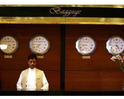 "<p>An employee stands behind the luggage counter at the Trident-Oberoi hotel in Mumbai</p><p><b>In the US, big hotel chains get to float above the fray. India brings them down to earth. At home, and in some markets abroad, companies like Marriott International, which owns the Courtyard and Fairmont brands and Starwood Hotels & Resorts, owner of Sheraton and W, have virtually eliminated real estate risk.</b></p><p>They have sold all or most of their own hotels, and instead make money by franchising their well-known names. This business strategy of minimizing in-house resources is known as ""asset-light.""</p><p>But in India, hotel companies are finding it hard to grow without getting bogged down in bulky assets like land and, well, hotels.</p>"