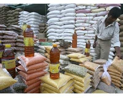 <P> <b>A vendor arranges packets of pulses at a wholesale market in Chandigarh</b> </P><P> India&#39;s annual food inflation eased for the fifth consecutive week in early November, probably due to new crop arrivals in the market, lending support to expectations that the central bank would hold rates steady in the near term. </P><P> The food price index in the year to November 6 rose 10.30 per cent, compared with 12.30 per cent in the previous week, as prices of rice, milk, vegetables and pulses eased, government data on Thursday showed. </P><P> The fuel price index in early November climbed 10.57 per cent compared with the prior week&#39;s 10.67 per cent reading. </P><P> <b>(Picture by Reuters)</b> </p>