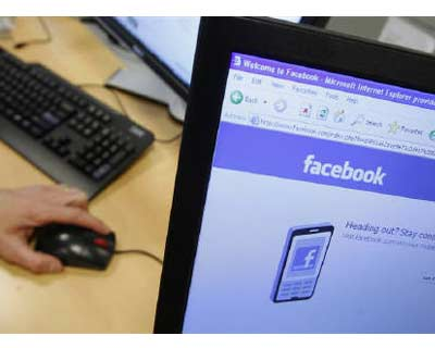 <p><b>A Facebook page is displayed on a computer screen in Brussels</b>