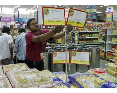 <p><b>A worker of a food superstore arranges price tags of the products inside a mall in Ahmedabad</b></p><p>The RBI will do everything possible to ensure inflation is contained without hurting growth, Governor Duvvuri Subbarao said on Tuesday.</p><p>India&#39;s wholesale price index rose an annual 8.31% in February on higher fuel and manufactured product prices, well above Reuters forecast of 7.79% and higher than January reading of 8.23%.</p><p>The Reserve Bank of India, which last week raised interest rates for the eighth time since last March, has warned both of inflationary pressures and emerging risks to growth.</p>