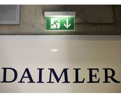 <p><b>A emergency exit sign is pictured above a logo of German car manufacturer Daimler AG, before the annual news conference in Stuttgart</b>