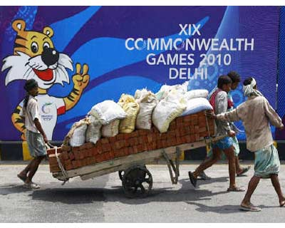 """<p><b>Labourers pull a hand cart loaded with bricks and sacks of sand in front of boards advertising the Commonwealth Games in New Delhi</b> </p><p> The CWG debacle shows the risk of such high profile sporting events -- there are limited benefits if you get it right but a vast investment and political downside if it all goes wrong. </p><p> Indian officials would have hoped a successful games might have helped build on India&#39;s narrative as an emerging superpower, perhaps drawing comparisons to rival China&#39;s 2008 Olympics. Instead, the Commonwealth Games -- due to start on Oct. 2 -- have become a national embarrassment. </p><p> Several big-name athletes have already pulled out of the games, while the CWG Federation complain of a """"filthy"""" athletes&#39; village littered with rubbish and stray dogs. </p><p> Most seriously, a footbridge to the main stadium collapsed, injuring 27 workers -- highlighting India&#39;s wider infrastructure problems and raising concerns about the q"""
