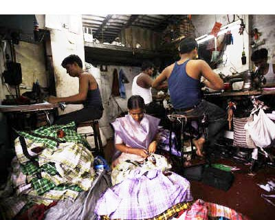 <p><b>Fifteen-year-old Saira (C) cuts shirt threads inside a garment factory in Mumbai</b> </p><p> The Reserve Bank of India urged commercial banks to continue lending to the microfinance sector, after a crackdown on their activities by Andhra Pradesh  government curbed collections and new business. </p><p> A delegation of banks told the Reserve Bank of India (RBI) on Wednesday that collections in Andhra Pradesh, the hub of the industry, had suffered significantly since October when the state rules came into effect, and warned that the problem showed signs of spreading to other states, an RBI statement said. </p><p> The RBI formed a panel in late October in response to the Andhra Pradesh rules. The panel is expected to submit its recommendations by mid-January. </p>
