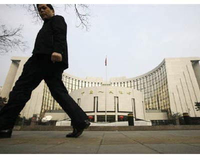 """<P> <b>A man walks past the headquarters of the People&#39;s Bank of China, the central bank, in Beijing</b> </P><P> China mainly looks at domestic factors rather than external ones in deciding its monetary policies, Chinese central bank governor Zhou Xiaochuan said on Monday. </P><P> Worries about European sovereign debt have fanned speculation that China will slow its exit from the loose, pro-growth monetary policy implemented at the height of the global financial crisis. </P><P> """"China is a big economy, and generally domestic factors are most important in adjusting domestic monetary policy under most circumstances,"""" Zhou told a news conference during the ongoing two-day US-China Strategic and Economic Dialogue. </P><P> His comments came in response to a question about whether the People&#39;s Bank of China gave more weight to the European debt crisis or domestic deposit rates, which are now negative in real terms, in deliberations about interest rates. </P>"""