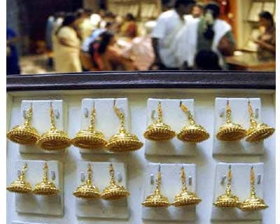 <p><b>Customers stand inside a gold jewellery showroom in Chennai</b>