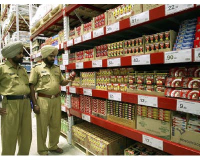 <p><b>Policemen stand inside cash-and-carry Wal-Mart store during its inauguration ceremony in Amritsar</b>
