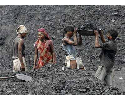 <p><b>Laborers work in a railway coal yard on the outskirts of Ahmedabad</b>