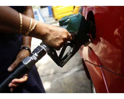 <p><b>An employee fills a customer's tank at a petrol pump in Kolkata</b>