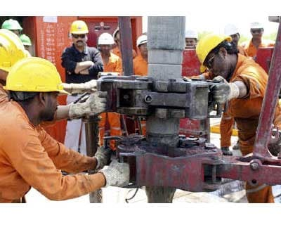 <p><b>Engineers of Oil and Natural Gas Corp (ONGC) work inside the Kalol oil field in Gujarat</b>