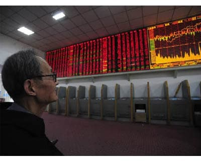 <p><b>An investor checks stock information at an electronic board at a brokerage house in Hefei, Anhui province</b>