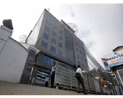 """<p><b>Security personnel stand guard in front of SKS Microfinance's head office in Hyderabad</b></p><p>SKS Microfinance, India's largest and only publicly listed microfinance institution, said on Tuesday it sold securitised loans worth Rs 550 cr in two tranches to banks.</p><p>The company also said it sold securitised loans worth Rs 60 cr to a non-banking financial company earlier this month.</p><p>""""The transactions will further augment the liquidity position of SKS Microfinance,"""" said Chief Financial Officer S Dilli Raj said, adding such loan markets """"had virtually ceased post the AP (Andhra Pradesh) MFI Act.""""</p>"""