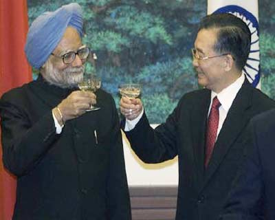 """<p><b>Indian Prime Minister Manmohan Singh (L) and Chinese Premier Wen Jiabao share a toast after a signing ceremony held at the Great Hall of the People in Beijing </b> </p><p> Chinese Premier Wen Jiabao told Indian Prime Minister Manmohan Singh on Friday the world was big enough for their two countries to develop and cooperate, sounding a positive note ahead of a visit planned for later this year. </p><p> The world&#39;s most populous countries have engaged in repeated diplomatic sparring over the last two years, reflecting growing friction over their disputed borders and roles as emerging global powers despite bilateral trade that has grown 30-fold since 2000. </p><p> \""""There is enough space in the world for India and China to achieve common development ... to have cooperation,\"""" Wen said at the beginning of a meeting with Singh on the sidelines of an Asia-Pacific summit in Hanoi. </p>"""