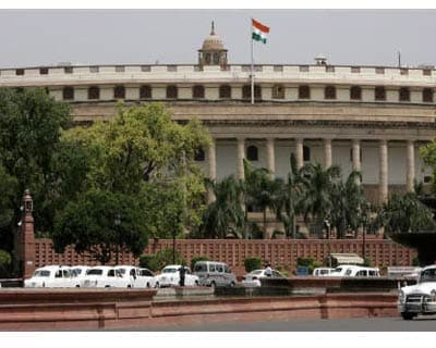 <p><b>Lawmakers arrive in their cars at the parliament on the opening day of the budget session in New Delhi</b>