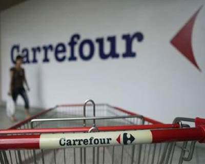 <p><b>A customer walks past a Carrefour outlet in Kuala Lumpur</b> </p><p> Parsvnath Developers said on Thursday French retailer Carrefour will open its first cash-and-carry store in India at one of the realtor&#39;s New Delhi malls. </p><p> In September, a Carrefour executive told that its first store in India will have a surface area of 5,000 square metres. </p><p> India&#39;s $450 billion retail sector is largely closed to foreign firms and favours small stores, which provide livelihoods for hundreds of thousands and serve a market of more than 1 billion. Multi-brand retail is restricted to cash-and-carry or wholesale outlets. </p>