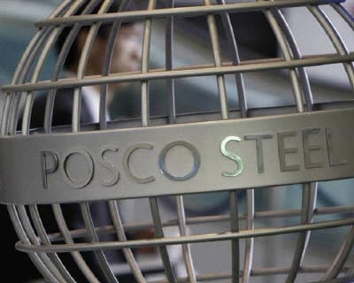 <p><b>An employee of steelmaker Posco walks at the company&#39;s headquarters in Seoul</b>