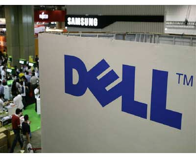 <p><b>Shoppers walk past a Dell booth at the COMEX information technology and consumers technology exhibition in Singapore</b>