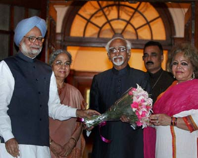 PM greets Hamid Ansari after he is re-elected Vice President