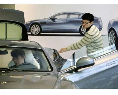 <p><b>Visitors look at the a car at a showroom in Beijing </b>