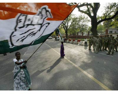 <p><b>A supporter waves a Congress party flag as she celebrates in front of the residence of Congress Party chief Sonia Gandhi in New Delhi.</b> </p><p> One of India&#39;s biggest corruption scandals from the 1980s has resurfaced to tarnish the ruling Congress party and embolden an opposition that has paralysed parliament with protests over graft accusations. </p><p> A senior leader of the opposition Bharatiya Janata Party (BJP) said the claims of kickbacks paid during a $1.4 billion defence deal would be brought to parliament, as a court decides whether to allow investigators to end their inquiry into the allegations. </p><p> Congress is already under pressure from the BJP&#39;s demands for a joint parliamentary inquiry into a $39 billion telecoms scam involving Congress-backed former Minister A. Raja, which shut down parliament for its December session. </p>