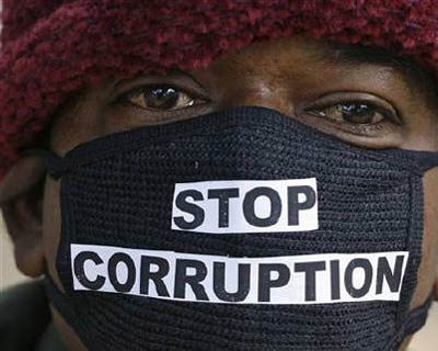 <p><b>A man takes part in a silent protest against the telecom corruption scandal in New Delhi.</b>