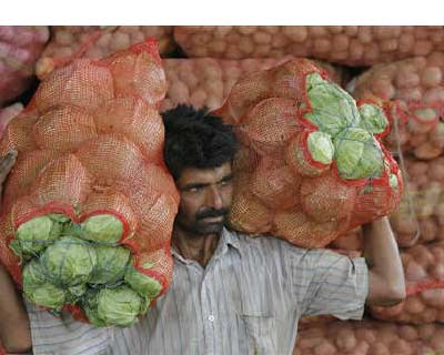 <b><p>A man carries sacks filled with cabbages at a wholesale vegetable market on the outskirts of Jammu.</b> </p><p> India's food price index rose 8.84% and the fuel price index climbed 13.96% in the year to Sept. 10, government data on Thursday showed. </p><p> In the previous week, annual food and fuel inflation stood at 9.47% and 13.01%, respectively. </p><p> The primary articles index was up 12.17%, compared with an annual rise of 13.04% a week earlier. </p>