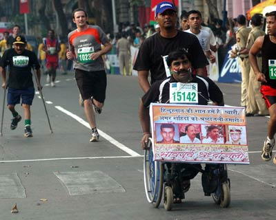 A participant of the wheelchair event pays homage to the martyrs of the Mumbai terror attacks.