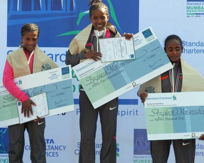 Ethiopia&#39;s Bizunesh Mohammed (centre) won the women&#39;s race in 2 hours, 31 minutes and 09 seconds, with compatriot defending champion Haile Kebebush (left) in second place and Azalech Masresha finishing third <P> <b>Picture by Divyakant Solanki</b> </P>