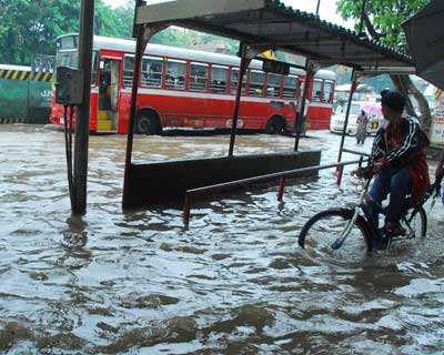 A suburban road submerged in a few feet of water after the monsoon hit the city on June 26. <P> <b>Picture by Suryakant Niwate</b> </P>