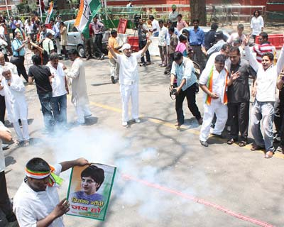 Congress supporters celebrating the victory with the fireworks in front of AICC office in New Delhi