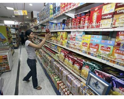 Retail: A customer shops at a grocery store in Lucknow in this July 2009 file photo. Retail firms are making a cautious entry into the cash-and-carry, or wholesale trading, format, betting on a huge demand base of unorganised independent stores, and in a bid to lure foreign investments.