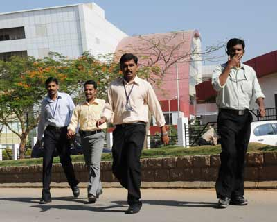 Satyam employees take a break from their work in Hyderabad on Wednesday