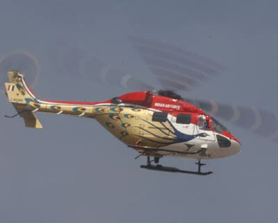A Sarang helicopter flying overhead at the Air Force Station, Yelahanka, during the rehearsal of Aero India 2009, in Bangalore