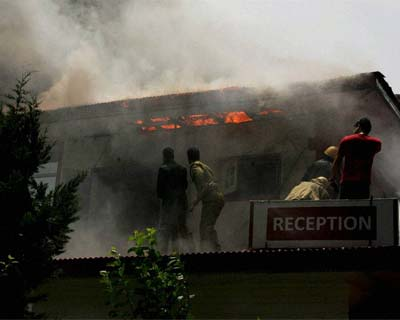 <p>Fire brigade personnel douse the flames after a fire broke out  in a hotel of Rajbagh area in Srinagar on Monday. All the tourists putting up in the building were evacuated to safety.</p>