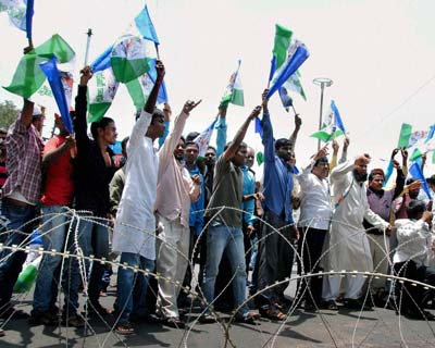 <p>Hyderabad: YSR Congress party activists celebrate party's victory in by-election near Chanchalguda jail in Hyderabad on Friday.</p>