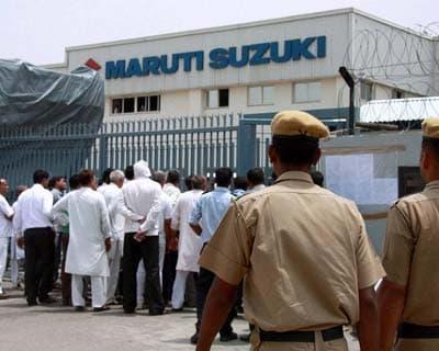 Policemen patrolling Manesar plant