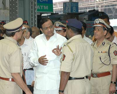The Home Minister talking to security forces at Chatrapati Shivaji Terminus.