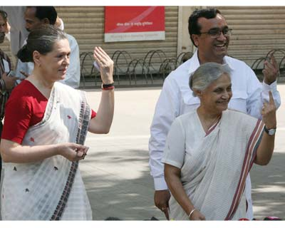We're still looking for post-poll alliances. Congress president Sonia Gandhi, Delhi CM Shiela Dikshit and Congress New Delhi constituency candidate Ajay Makhan outside the Nirman Bhawan polling station