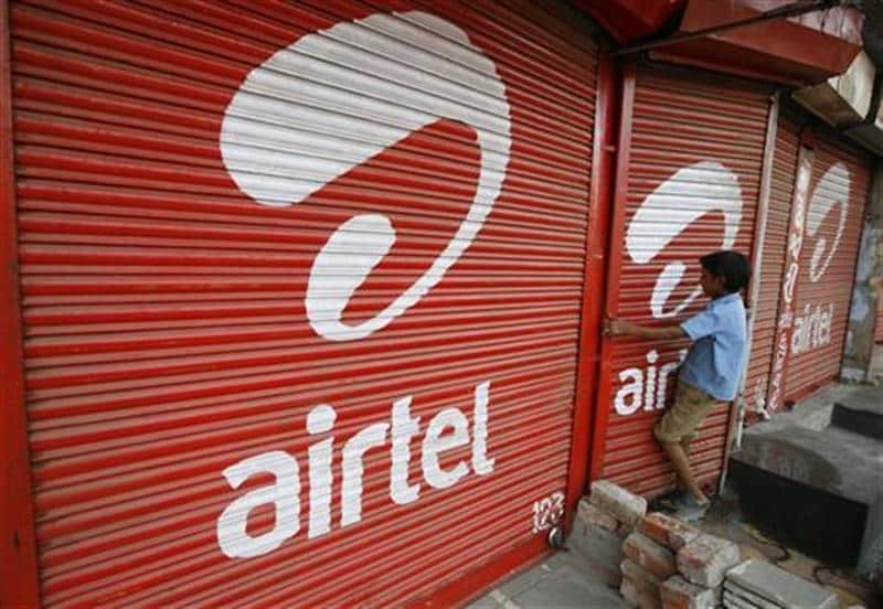 <p><b>A boy closes the shutter of a shop painted with an advertisement for Bharti Airtel in Ahmedabad</b></p><p>The telecoms shares extended their fall on Tuesday as a regulatory proposal to increase the price of 2G spectrum continued to hurt sentime