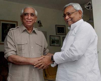 New Delhi: NDA's Vice Presidential candidate Jaswant Singh shakes hands with Bihar Chief Minister Nitish Kumar before a meeting at in New Delhi.