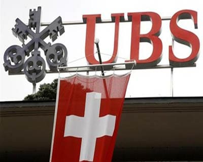 UBS Q1 net shrinks amid own debt charge