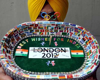 Artist Harwinder Singh Gill displays his creation on London Olympics 2012 in Amritsar