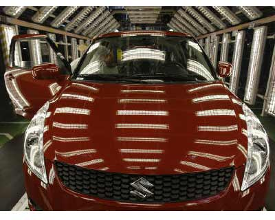 <p>A worker checks a car on the inspection line in the Hungarian plant of Japanese car maker Suzuki in the town of Esztergom</p><p></b>Suzuki Motor Corp posted a 20% drop in quarterly operating profit as the March 11 earthquake hampered production, a