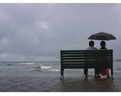 <p>A couple rests on a seaside promenade during a rain shower in Kochi</p><p><b>Monsoon rains need to pick up in August after two straight weeks of below normal showers to help make up for the loss in soil moisture and aid vegetative growth of crops