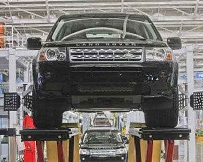 <p><b>Jaguar Land Rover Freelander 2 vehicles are displayed on the production line for the media at their newly-inaugurated production plant in Pune</b></p><p>Tata Motors' global vehicle sales rose 26% in March from a year earlier, the Indian com