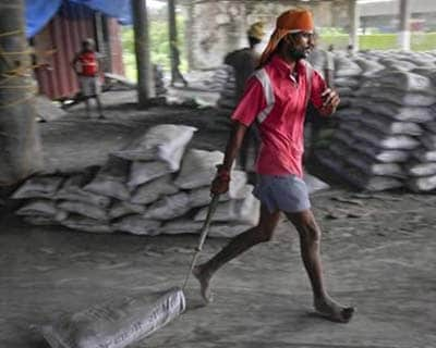 <p><b>A labourer pulls a sack of cement along the floor after unloading it from a freight train at a railway station in Mumbai</b></p><p>Cement makers fall on fears the Competition Commission of India (CCI) will rule against the sector as it delibera